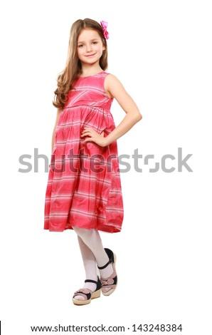 Full length studio photo  girl wearing pink summer dress standing on white background - stock photo