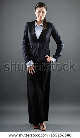 Full length studio portrait of a successful businesswoman standing with hand on hip