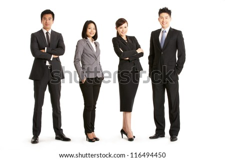 Full Length Studio Portrait Of Chinese Business Team - stock photo