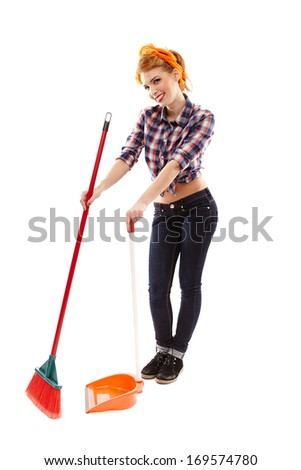 Full length studio portrait of sexy housewife sweeping the floor, isolated over white background - stock photo