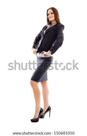 Full length studio portrait of smiling businesswoman with hands in waist isolated on white background