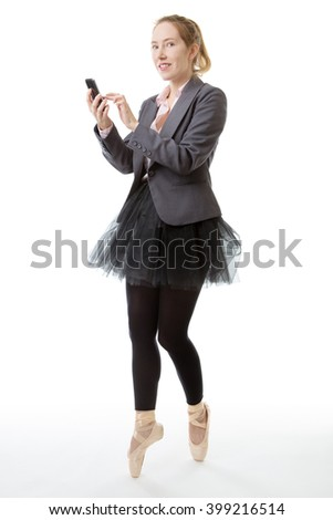 Full length studio shot of a business ballerina en pointe with a mobile phone out in front of her.  isolated on white - stock photo