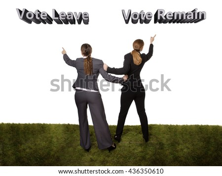 Full length studio shot of two business women, taken from behind, standing on grass. wanting to go in different directions