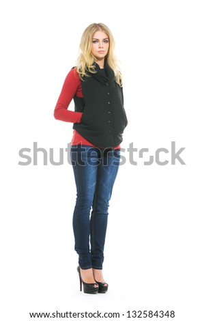 Full length The young girl in jeans posing in studio - stock photo