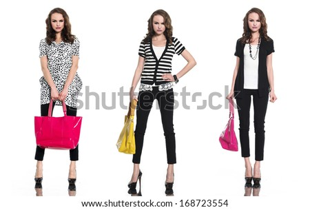 full length three young woman in with bag posing at studio - stock photo