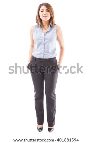 Full length view of a confident and successful businesswoman dressed casually on a white background