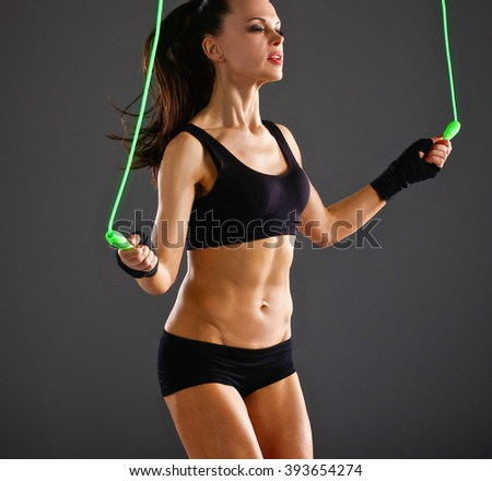 Full length view of an attractive woman with jumping rope - stock photo