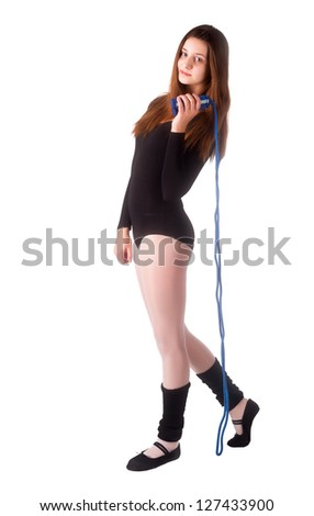 Full length view of an attractive woman with jumping rope; Isolated on white - stock photo