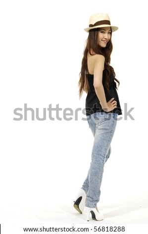 Full length view of girl standing on white background wearing hat