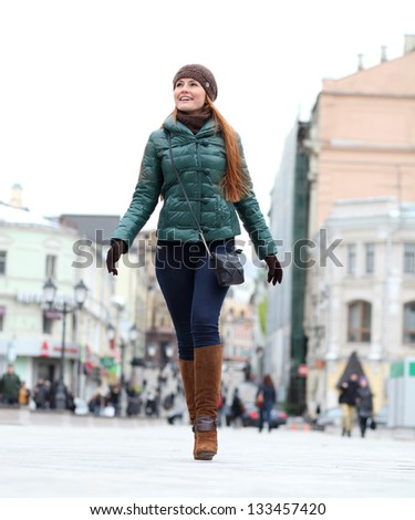 Full length, Walking woman in autumn Moscow street - stock photo