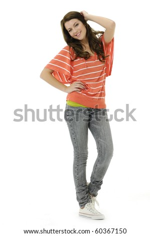 Full length woman in jeans posing in the studio - stock photo