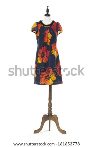 full-length Women evening dress on a dummy isolated on a white background - stock photo