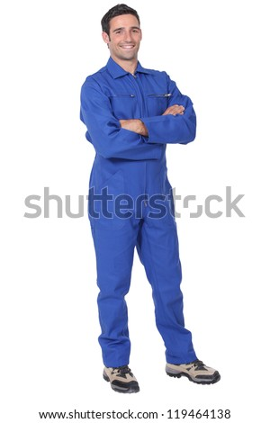 Full length worker in a boiler suit - stock photo