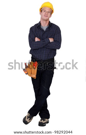Full length worker with a tool belt - stock photo