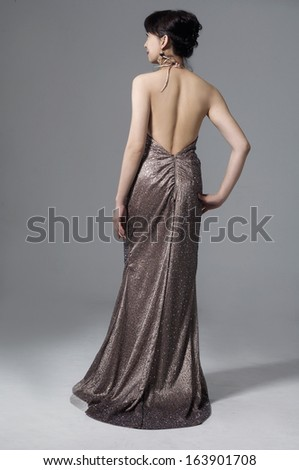 full-length young and beautiful bridge in luxurious dress back in studio - stock photo
