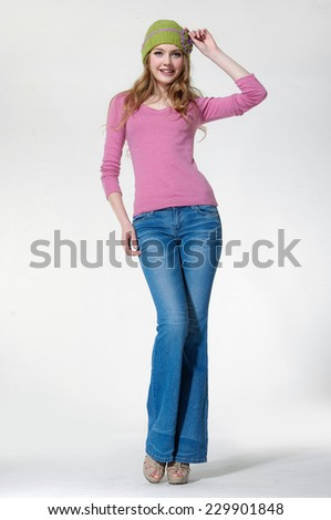 Full length young girl smiling and looking, full length portrait isolated on white background - stock photo