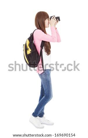 full length young girl taking a picture using digital camera - stock photo