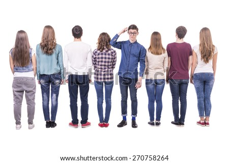 Full length. Young group standing with his back to the camera except one guy. isolated on white background. - stock photo