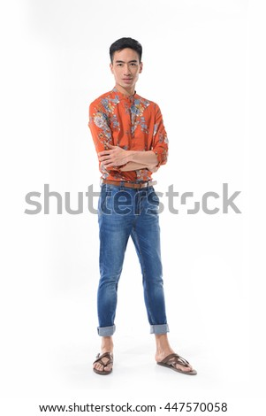 Full length Young man in jeans standing on white background - stock photo