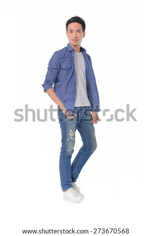 Full length Young man in jeans walking in studio - stock photo