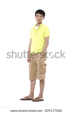 Full length Young man in shorts standing on white background - stock photo