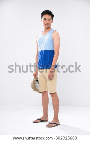 Full length Young man in shorts with hat standing on white background - stock photo