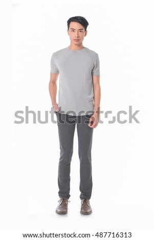 Full length young man standing in jeans posing