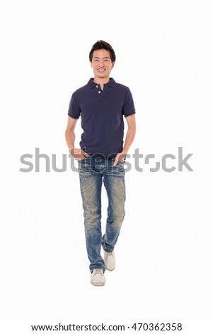 Full length young man walking in studio