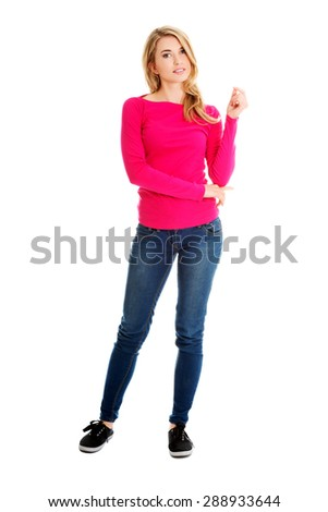 Full length young woman smiling to the camera. - stock photo