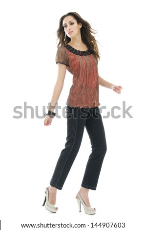full-length young woman standing against on white background
