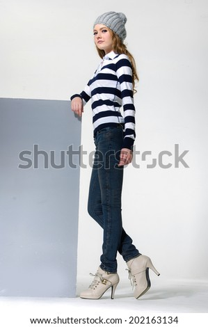 full-length young woman with cube standing posing - stock photo