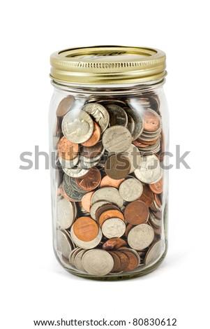 Full mason jar of change  on a white background. - stock photo