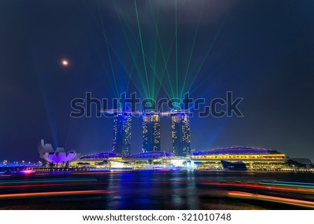 Full moon and lighting show over Singapore skylines. Mid-autumn is a big holiday in Asia with festival are held almost everywhere to celebrate with moon cake, lion dancing, lantern - stock photo