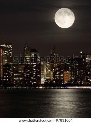 Full moon and Manhattan - stock photo