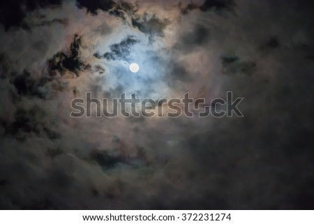 full moon and night sky with cloud - stock photo
