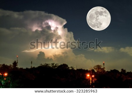 Full moon and thunder lightnings and storm at dark night background