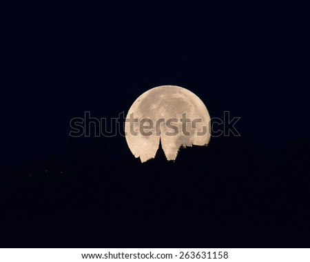 Full moon at Wat Phra That Doi Suthep is a major tourist destination of Chiang Mai, Thailand. - stock photo