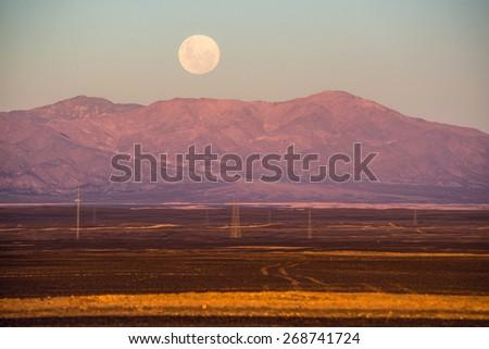 Full moon, Atacama desert of Chile - stock photo