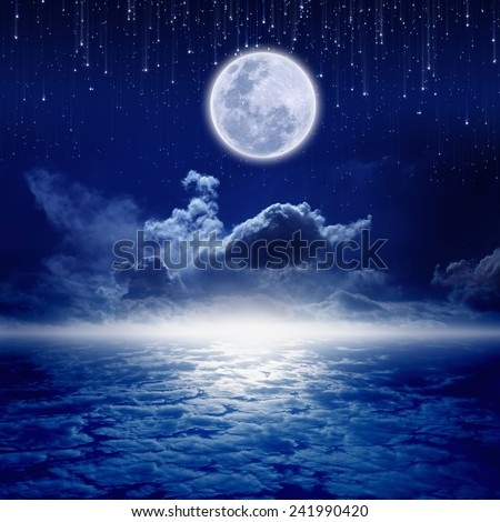 Full moon in night sky with falling stars and mysterious glowing horizon. Elements of this image furnished by NASA http://visibleearth.nasa.gov - stock photo