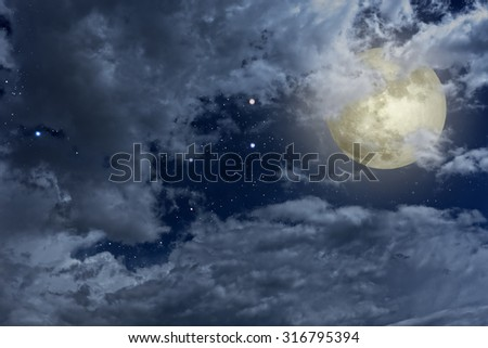 Full moon night sky with clouds and stars - stock photo