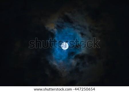 full moon night the moon is shining through the cloud - stock photo