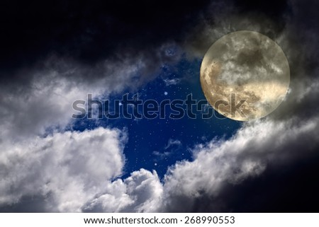 Full moon night with a hole in the clouds and stars