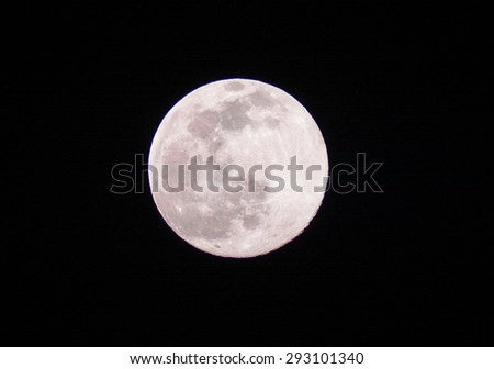 Full moon on the black background - stock photo