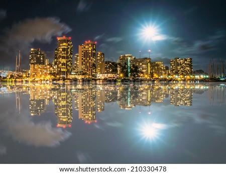 Full moon over Ala Wai Boat Harbor with Diamond Head in Background. - stock photo