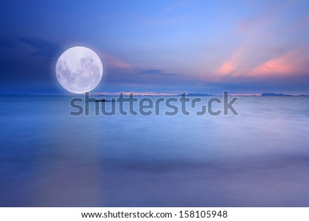 Full moon over blue sea and sky ,Long exposure technique - stock photo