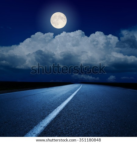 full moon over clouds and asphalt road - stock photo