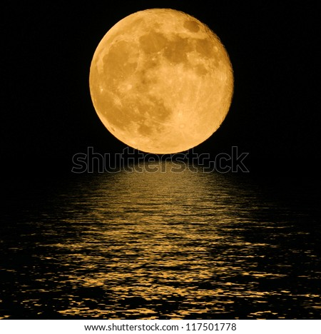 Full  moon over cold night water - stock photo