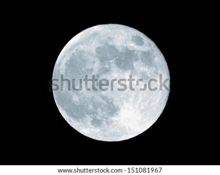Full moon over dark black sky at night