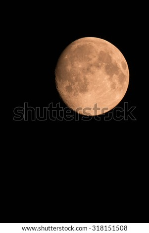 Full moon over dark black sky at night. - stock photo
