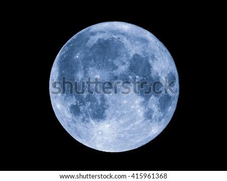 Full moon over dark black sky seen with a telescope - stock photo
